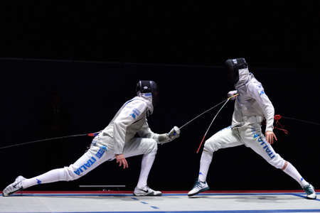 St. Petersburg Russia  May 2 2015: Andrea Cassara of Italy left vs Daniele Garozzo of Italy in semifinal of 41th International fencing tournament St. Petersburg Foil. The tournament is the stage of FIE World Cup Éditoriale