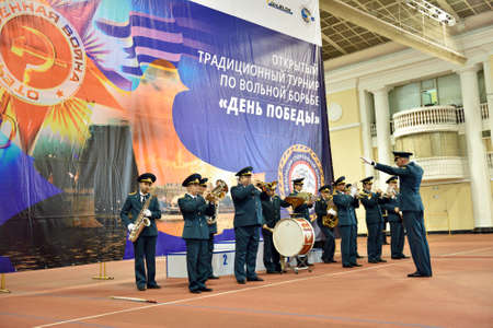 plays: St. Petersburg, Russia - May 6, 2015: Military orchestra plays on the opening ceremony of International freestyle wrestling tournament Victory Day in Mikhailovsky manege.This traditional competitions dedicated to the Victory in Great Patriotic War Editorial