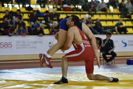St. Petersburg, Russia - May 6, 2015: Aslan Kakhidze of Kazakhstan against unidentified athlete during International freestyle wrestling tournament Victory Day in Mikhailovsky manege.This traditional competitions dedicated to the Victory in Great Patrioti