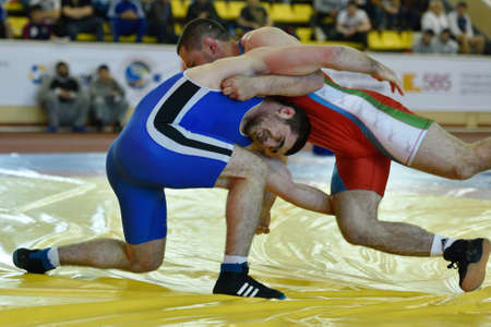 wrestlers: St. Petersburg, Russia - May 6, 2015: Unidentified wrestlers during International freestyle wrestling tournament Victory Day in Mikhailovsky manege.This traditional competitions dedicated to the Victory in Great Patriotic War Editorial