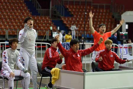 fencing foil: St. Petersburg, Russia - May 3, 2015: Korean team during team quarterfinal match against Italy in 41th International fencing tournament St. Petersburg Foil. The tournament is the stage of FIE World Cup Editorial