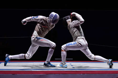 fencing foil: St. Petersburg, Russia - May 3, 2015: Match for 3rd place Italy vs France during 41th International fencing tournament St. Petersburg Foil. The tournament is the stage of FIE World Cup Editorial