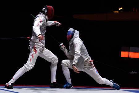 fencing foil: St. Petersburg, Russia - May 3, 2015: Final match Russia vs China during 41th International fencing tournament St. Petersburg Foil. The tournament is the stage of FIE World Cup