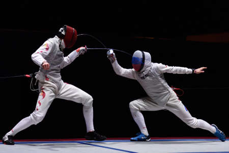 St. Petersburg, Russia - May 3, 2015: Final match Russia vs China during 41th International fencing tournament St. Petersburg Foil. The tournament is the stage of FIE World Cup