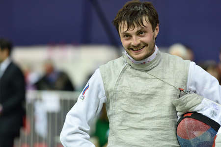 fencing foil: St. Petersburg, Russia - May 2, 2015: Dmitry Rigin of Russia after the 18 final of 41th International fencing tournament St. Petersburg Foil. The tournament is the stage of FIE World Cup