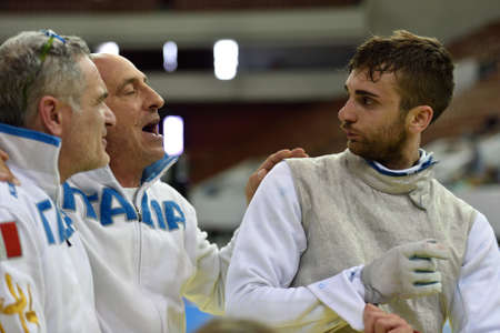 fencers: St. Petersburg, Russia - May 2, 2015: Daniele Garozzo of Italy with coaches after the 18 final of 41th International fencing tournament St. Petersburg Foil. The tournament is the stage of FIE World Cup