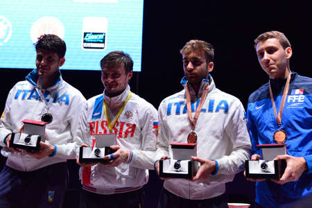 fencing foil: St. Petersburg, Russia - May 2, 2015: Winners of the International fencing tournament St. Petersburg Foil during the award ceremony. Left to right: Andrea Cassara of Italy, Dmitry Rigin of Russia, Daniele Garozzo of Italy, Vincent Simon of France