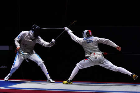 finalists: St. Petersburg, Russia - May 2, 2015: Dmitry Rigin of Russia vs Andrea Cassara of Italy in the final of 41th International fencing tournament St. Petersburg Foil. The tournament is the stage of FIE World Cup Editorial