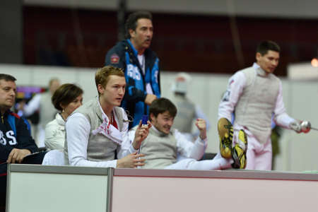 fencers: St. Petersburg, Russia - May 3, 2015: Russian team during team quarterfinal match against Japan in 41th International fencing tournament St. Petersburg Foil. The tournament is the stage of FIE World Cup Editorial