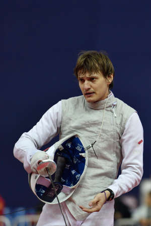 cup of russia: St. Petersburg, Russia - May 3, 2015: Alexey Cheremisinov of Russia in team quarterfinal of 41th International fencing tournament St. Petersburg Foil. The tournament is the stage of FIE World Cup Editorial
