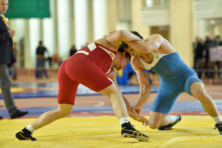 wrestlers: St. Petersburg, Russia - May 6, 2015: Unidentified wrestlers during International freestyle wrestling tournament Victory Day. This traditional competitions dedicated to the Victory in WWII Editorial