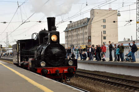 postwar: St. Petersburg, Russia - May 7, 2015: People watching the parade of steam locomotives dedicated to the WWII Victory Day. The event recreates the atmosphere of the postwar years for veterans and spectators
