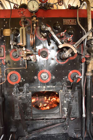firebox: St. Petersburg, Russia - May 7, 2015: Firebox with opened firedoors in the steam locomotive Ov324 made in 1905. The parade of steam locomotives dedicated to the WWII Victory Day