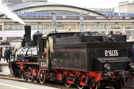 steam locomotives: St. Petersburg Russia  May 7 2015: People watching the parade of steam locomotives dedicated to the WWII Victory Day. The event recreates the atmosphere of the postwar years for veterans and spectators