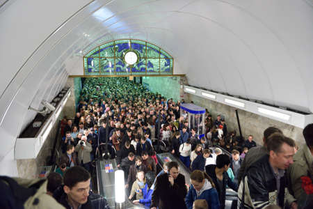 going for it: St. Petersburg Russia  May 9 2015: Crowd in the subway station Admiralteyskaya going to watch the parade celebrating the Victory in WWII. The station working only for exit but nevertheless it was overloaded