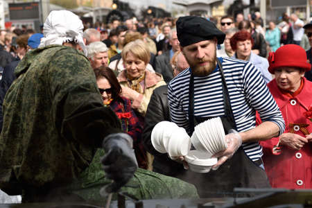steam locomotives: St. Petersburg Russia  May 7 2015: People at the field kitchen during the parade of steam locomotives. The event dedicated to the WWII Victory Day