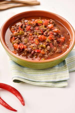 con: Chili con carne in a rustic bowl Stock Photo