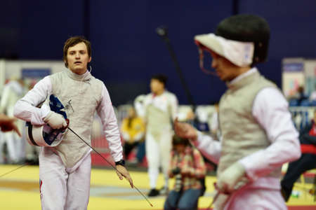 thrust: St. Petersburg Russia  May 3 2015: Alexey Cheremisinov of Russia in team semifinal of 41th International fencing tournament St. Petersburg Foil. The tournament is the stage of FIE World Cup