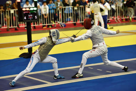 fencing foil: St. Petersburg, Russia - May 2, 2015: Erwan Le Pechoux of France vs Haiwei Chen of China in 18 final of 41th International fencing tournament St. Petersburg Foil. The tournament is the stage of FIE World Cup