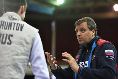 fencing foil: St. Petersburg Russia  May 3 2015: Coach Dmitry Kulayev and Pavel Borontov of Russia during 41th International fencing tournament St. Petersburg Foil. The tournament is the stage of FIE World Cup
