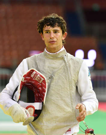 fencing foil: St. Petersburg Russia  May 2 2015: Lorenzo Nista of Italy in 132 final of 41th International fencing tournament St. Petersburg Foil. The tournament is the stage of FIE World Cup