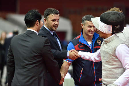 fencing foil: St. Petersburg, Russia - May 3, 2015: Italian team handshakes with judges after team semifinal of 41th International fencing tournament St. Petersburg Foil. The tournament is the stage of FIE World Cup Editorial