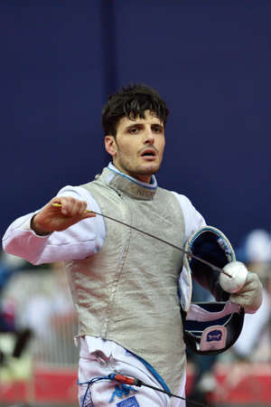fencing foil: St. Petersburg Russia  May 3 2015: Andrea Cassara of Italy in team semifinal of 41th International fencing tournament St. Petersburg Foil. The tournament is the stage of FIE World Cup Editorial