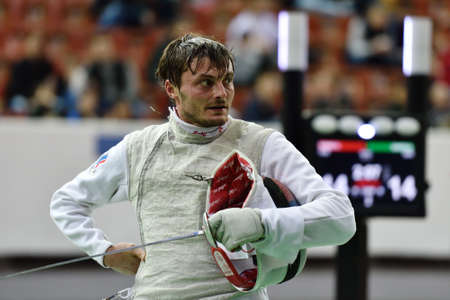 fencing foil: St. Petersburg Russia  May 2 2015: Dmitry Rigin of Russia in 116 final of 41th International fencing tournament St. Petersburg Foil. The tournament is the stage of FIE World Cup