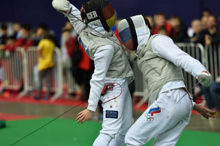 fencing foil: St. Petersburg, Russia - May 2, 2015: Andre Sanita of Germany vs Dmitry Rigin of Russia in 116 final of 41th International fencing tournament St. Petersburg Foil. The tournament is the stage of FIE World Cup