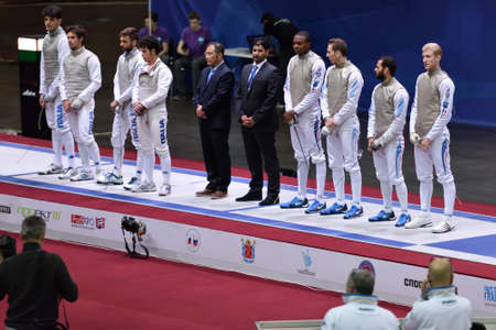 fencing foil: St. Petersburg Russia  May 3 2015: Teams Italy and France before the match for 3rd place of International fencing tournament St. Petersburg Foil. The tournament is the stage of FIE World Cup