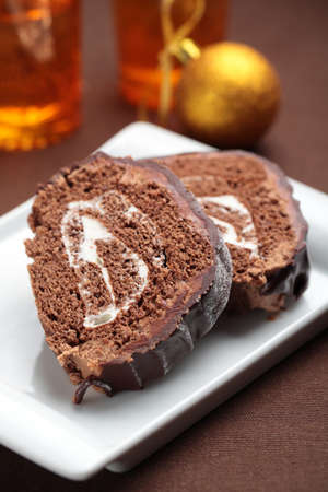 yule log: Slices of Yule log cake topped with chocolate on a Christmas table