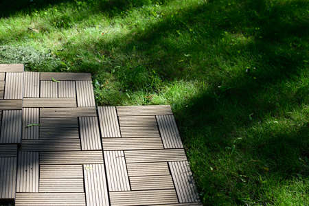 decking: Floor decking on a lawn in a summer day