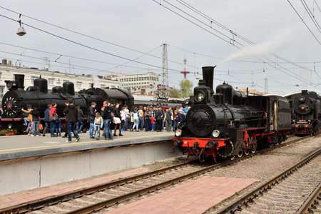 postwar: St. Petersburg Russia  May 7 2015: People watching the parade of steam locomotives dedicated to the WWII Victory Day. The event recreates the atmosphere of the postwar years for veterans and spectators