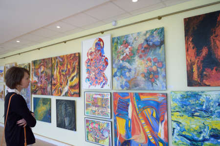 spectator: St. Petersburg, Russia - June 7, 2015: Spectator at the first exhibition of the project Modern artists of the world. More than 300 paintings and sculptures exposed in the Center of modern art of Congress Palace