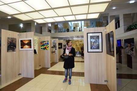congress center: St. Petersburg, Russia - June 7, 2015: People at the first exhibition of the project Modern artists of the world. More than 300 paintings and sculptures exposed in the Center of modern art of Congress Palace Editorial