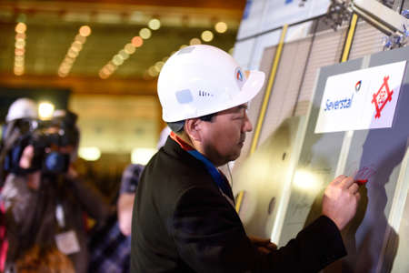 resentation: Vsefolozhsk, Leningrad oblast, Russia - June 5, 2015: Makoto Murase, executive director at Mitsui & Co. Steel, at the resentation of the joint enterprise Severstal-SSC-Vsevolozsk Editorial