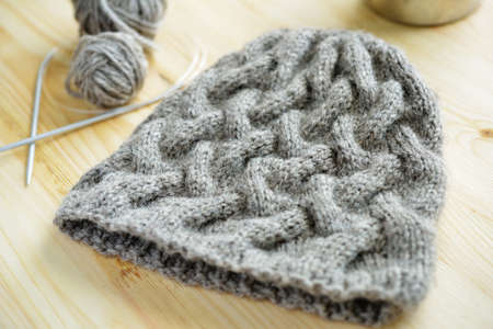 knitting needles: Knitted hat and knitting needles on a table