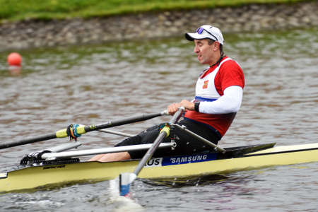 sculling: St. Petersburg, Russia - June 12, 2015: Denis Kleshnev in semifinal of rowing competitions on single scull during the Golden Blades Regatta. It is is one of the best known regatta in Russia