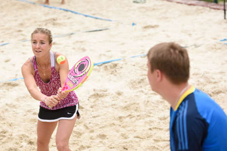 voronin: Moscow Russia  May 31 2015: Stanislava Naumova and Pavel Voronin in the match of Russian beach tennis championship. 120 adults and 28 young athletes compete in the tournament