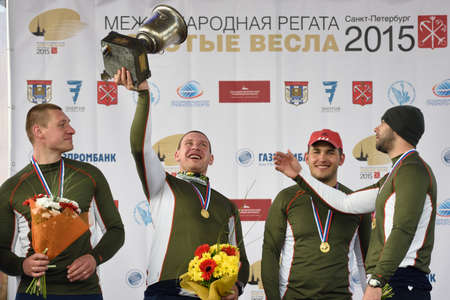 eights: St. Petersburg, Russia - June 12, 2015: Winners of sweep rowing competitions on eights boat during the medal ceremony of Golden Blades Regatta. It is is one of the best known regatta in Russia