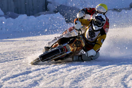 individual sport: Novosibirsk Russia  December 20 2014: Unidentified bikers during the semifinal individual rides of Russian Ice Speedway Championship. The sports returns to the sport arenas after a decline Editorial
