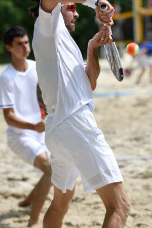 double game: Moscow Russia  May 30 2015: Sergey Kuptsov in front and Nikita Burmakin in the match of Russian beach tennis championship. 120 adults and 28 young athletes compete in the tournament