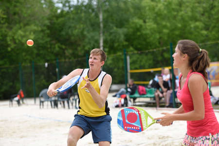 nikolay: Moscow Russia  May 31 2015: Yulia Chubarova and Nikolay Guriev in the match of Russian beach tennis championship. 120 adults and 28 young athletes compete in the tournament Editorial