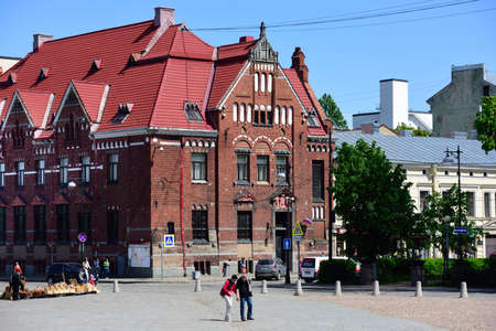 gustaf: Vyborg Leningrad oblast Russia  June 06 2015: People at the building of Suomen Pankki on the Lenin avenue. Built in 1910 by design of Carl Gustaf Nystrom now it houses the municipality