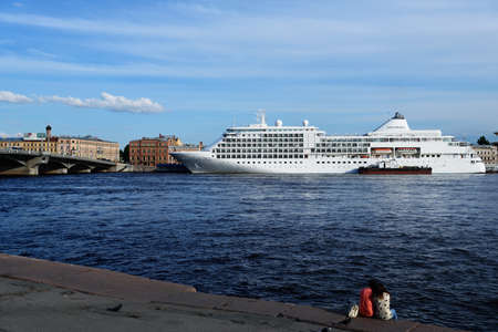 accommodate: St. Petersburg Russia  June 23 2015: Cruise ship Silver Whisper anchored at English Embankment. The liner of company SILVERSEA may accommodate 382 guests