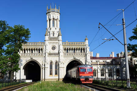 commuter train: St. Petersburg Russia  June 07 2015: Commuter train arrives to the train station Novy Peterhof. The station was built in 18541857 by design of N Benois Editorial