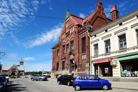 gustaf: Vyborg, Leningrad oblast, Russia - June 06, 2015: People at the building of Suomen Pankki on the Lenin avenue. Built in 1910 by design of Carl Gustaf Nystrom, now it houses the municipality