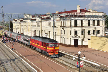 railroad station: Tula, Russia - May 23, 2015: Passenger train on the railroad station Moskovsky. The station building was erected in 1913 and then reconstructed in 1952-1955 Editorial