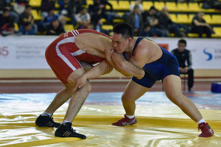 St. Petersburg, Russia - May 6, 2015: Aslan Kakhidze of Kazakhstan against unidentified athlete during International freestyle wrestling tournament Victory Day in Mikhailovsky manege.This traditional competitions dedicated to the Victory in WWII Editöryel