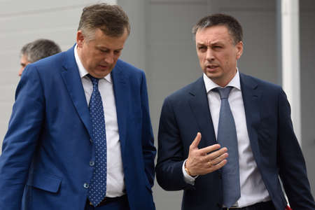 governor: St. Petersburg, Russia - June 30, 2015: Governor of Leningrad oblast Alexander Drozdenko left and chairman of the Board of Directors of Amira group Andrey Saramud during the opening of the Megapolis plant. Its Russias largest plant producing the lightin